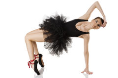 Ballerina in black stretching Royalty Free Stock Images