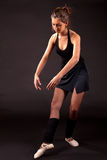Ballerina black tutu in ballet pose Stock Photos