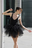 Ballerina in black tutu dancing Stock Photography