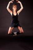 Ballerina black tutu jumping. Woman in black tutu jumping Royalty Free Stock Images