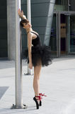 Ballerina in black tutu near a pole Stock Image