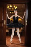 Ballerina in black tutu standing on pointes Stock Photography