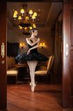 Ballerina in black tutu standing on pointes Royalty Free Stock Photo