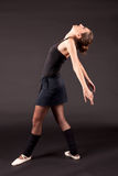 Ballerina black tutu. Woman in black tutu looking up and standing in profile Royalty Free Stock Images