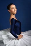 Ballerina on blue background Royalty Free Stock Photo