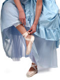 Ballerina in blue dress. In her shoes Stock Images