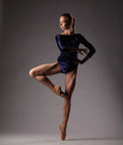 Ballerina in blue outfit, studio background. Royalty Free Stock Image