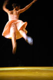 Ballerina in blur. Ballerina on stage doing jump in blur stock photo