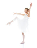 Ballerina child raised her leg up and pulling sock stock photos