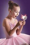 Ballerina children looking in the magic mirror stock images