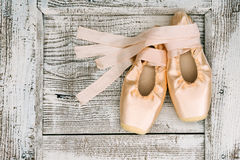 Ballerina classical shoes. Classical shoes for ballerina, flat lay on wooden surface Royalty Free Stock Images
