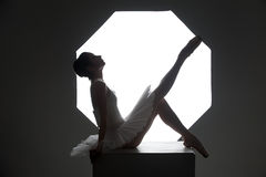 Ballerina on the cube. Ballerina posing on the cube in the studio Stock Image
