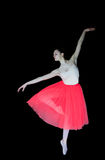 Ballerina in dance position, black background Royalty Free Stock Photography