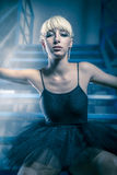 Ballerina dancer in an industry area, sensual blonde woman with Royalty Free Stock Photos