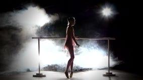 Ballerina dancer near the barre. smoke stock footage