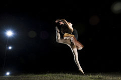 Ballerina dancer at night, outdoors. Ballerina dancing outdoors at night Royalty Free Stock Images