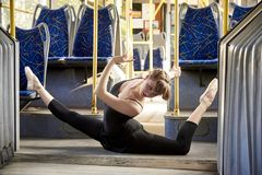 Ballerina. A ballerina dances in town transport stock photo