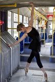 Ballerina. A ballerina dances in town transport royalty free stock photography