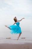 Ballerina dancing on the beach Stock Photo