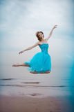 Ballerina dancing on the beach Royalty Free Stock Photo