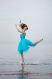 Ballerina dancing on the beach Stock Image