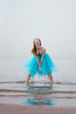 Ballerina dancing on the beach Stock Photo