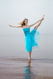 Ballerina dancing on the beach Stock Photography