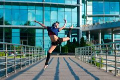 Ballerina dancing in casual clothes jumping on Royalty Free Stock Photos