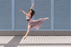 Ballerina dancing in casual clothes jumping on Royalty Free Stock Photo