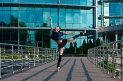 Ballerina dancing in casual clothes standing on Stock Images