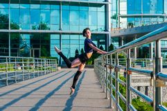Ballerina dancing in casual clothes standing on Royalty Free Stock Images