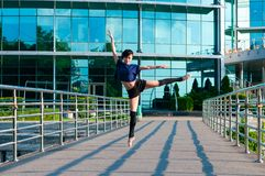 Ballerina dancing in casual clothes standing on Royalty Free Stock Image