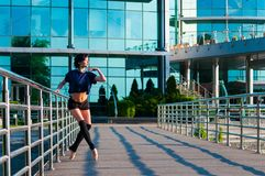 Ballerina dancing in casual clothes standing on Stock Photography