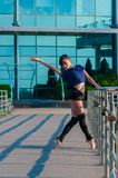 Ballerina dancing in casual clothes standing on Stock Photos