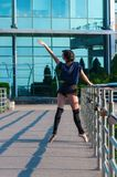 Ballerina dancing in casual clothes standing on Royalty Free Stock Photos