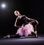 Ballerina dancing. In the dark studio Stock Image