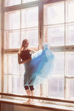 Ballerina is dancing in front of a large window Royalty Free Stock Photos