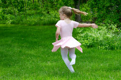 Ballerina dancing in the garden Stock Image