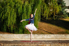 Ballerina dancing hipster on the street. Royalty Free Stock Image