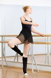 Ballerina dancing near barre in dancing hall Royalty Free Stock Image