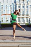 Ballerina is dancing near the palace Stock Image