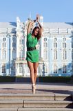 Ballerina is dancing near the palace Stock Photography
