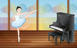 A ballerina dancing near the piano Royalty Free Stock Photography