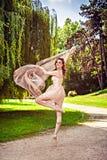 Ballerina dancing outdoors Stock Photography