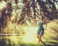 Ballerina dancing outdoors in a spray of water. Royalty Free Stock Photo