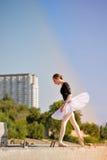 Ballerina dancing in the street. Stock Images