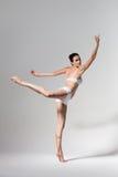 Ballerina dancing in studio Stock Photo