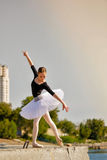 Ballerina dancing on the waterfront. Royalty Free Stock Image