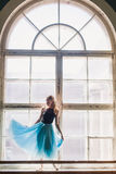Ballerina dancing at window sill background Royalty Free Stock Images