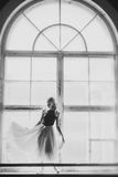 Ballerina dancing at window sill background Royalty Free Stock Photography